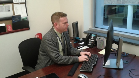 Steven M. D'Ambrosio, director of admissions, works in his office in Taft Hall. By Shonda Ellsberry, CCC Journalism Program