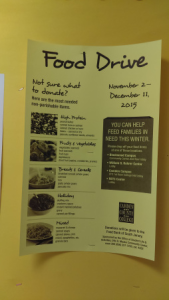 A sign promotes the food drive. By Samuel Smith, CCC Journalism Program