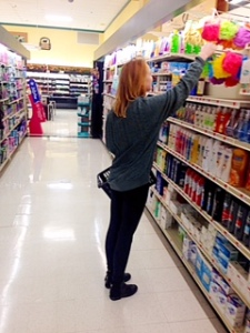 Alex Bradley scans aisles for trip items. By Analisa Simpson, CCC Journalism Program