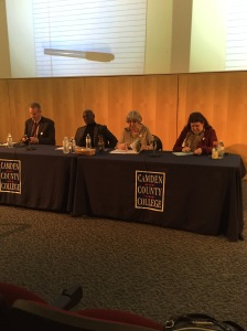 (From left to right) Panel members Don Borden, Robert Hammond, Elaine Bobrove and Rita Connolly look over their notes before the equity panel discussion. By Frank Rosa, CCC Journalism Program