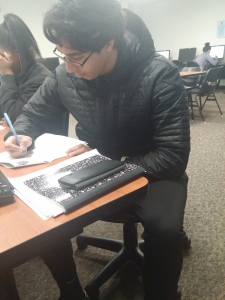 Chris Reyes works to complete his graduation application during the final days of the fall semester. By Reet Taylor, CCC Journalism Program