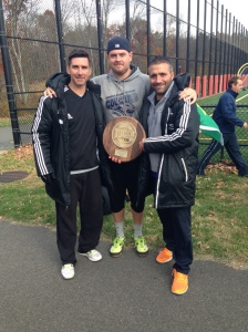 Coach Giuseppe Lamberti pictured with assistant coaches holding the Garden State Athletic Conference Coach of the Year Award.  (From left: Jimmy Connors, Andrew Baus, Giuseppe Lamberti)