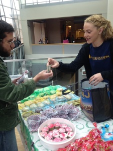 Phi Theta Kappa member Stephanie Angeline makes a sale at the fundraiser. By Mackenzie Brown, CCC Journalism Program