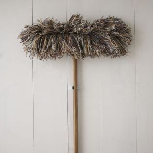 A mop leans against a wall. By Brian Garris, CCC Journalism Program