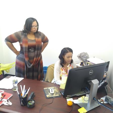 Janelle Gibson (left), a financial aid counselor at Camden County College, converses with Jennifer Garrett, financial aid manager. By Janene Francesco, CCC Journalism Program
