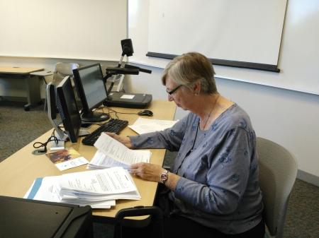 Secondary and Elementary Education Professor Karen Feldman grades students' quizzes. By Imani Brown, CCC Journalism Program